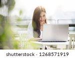 beautiful asian self employed... | Shutterstock . vector #1268571919
