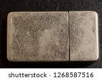 gasoline lighter at dark wooden ...   Shutterstock . vector #1268587516