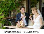 bride and groom drinking wine...   Shutterstock . vector #126865943