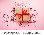 gift box wrapped in brown... | Shutterstock . vector #1268692360