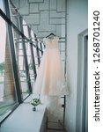 wedding dress of the bride.... | Shutterstock . vector #1268701240