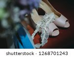 beautiful shoes of the bride.... | Shutterstock . vector #1268701243