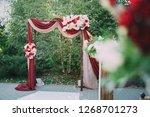 beautiful wedding archway. arch ... | Shutterstock . vector #1268701273