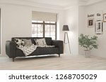 white room with sofa and winter ... | Shutterstock . vector #1268705029