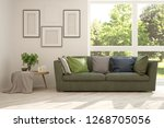 white room with sofa and green... | Shutterstock . vector #1268705056