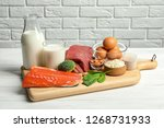 different natural food on table.... | Shutterstock . vector #1268731933