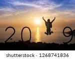 silhouette young woman jumping... | Shutterstock . vector #1268741836