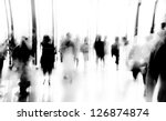 Stock photo business people activity standing and walking in the lobby motion blurred black and white 126874874