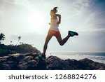 young fitness woman trail... | Shutterstock . vector #1268824276
