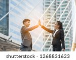 businessmen hand in hand | Shutterstock . vector #1268831623