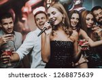 sing and drink. black dress.... | Shutterstock . vector #1268875639