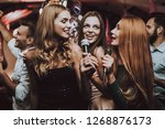 girls sing. trendy nightclub.... | Shutterstock . vector #1268876173