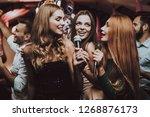 girls sing. trendy nightclub.... | Shutterstock . vector #1268876173