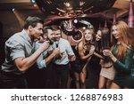 vocal battle. cheerful. smile....   Shutterstock . vector #1268876983