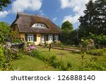 Cottage With Thatched Roof And...