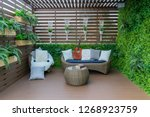 seating in the garden on the... | Shutterstock . vector #1268923759