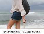 volunteer woman collecting... | Shutterstock . vector #1268950456
