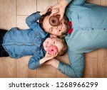 funny kid and father with donut ... | Shutterstock . vector #1268966299