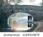 Couple Walking Under A Stone...