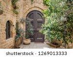 old wooden door. entrance to... | Shutterstock . vector #1269013333