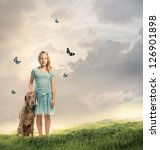 Young Blonde Girl with her Dog on a Magical Mountain - stock photo