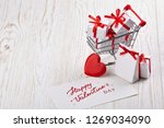 shopping trolley with gift... | Shutterstock . vector #1269034090