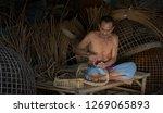 elderly man is craftsman rustic ...   Shutterstock . vector #1269065893