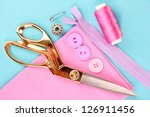sewing accessories and fabric... | Shutterstock . vector #126911456