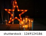 decorative star with lamps on a ... | Shutterstock . vector #1269124186