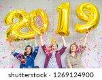 three friends enjoying party ... | Shutterstock . vector #1269124900