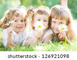 children with flowers lying on... | Shutterstock . vector #126921098