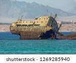 a badly corroded shipwreck of a ...   Shutterstock . vector #1269285940