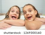 two funny girls bathing in the... | Shutterstock . vector #1269300160