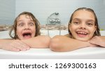 two sisters bathe in the bath... | Shutterstock . vector #1269300163