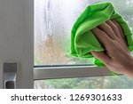 male hand cleaning condensate...   Shutterstock . vector #1269301633