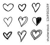 set of nine hand drawn heart.... | Shutterstock .eps vector #1269302659