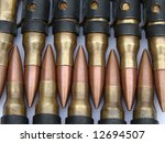 Small photo of Belt of Machine gun Bullets from a General Purpose Machine Gun GPMG known as the Gimpy