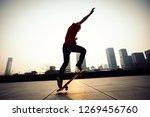 skateboarder skateboarding at... | Shutterstock . vector #1269456760