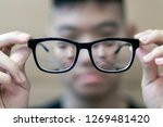 The black frame glasses on the...