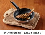 fried fish appetizers in a pan. ...   Shutterstock . vector #1269548653