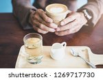 hand male holding cup of coffee ... | Shutterstock . vector #1269717730