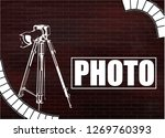 camera and photos on a brick... | Shutterstock .eps vector #1269760393