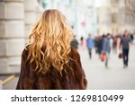 beauty girl with blonde curly... | Shutterstock . vector #1269810499