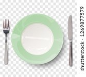 empty plate in light green... | Shutterstock .eps vector #1269877579
