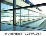 modern blue glass wall of... | Shutterstock . vector #126991064