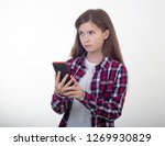surprised young girl holding...   Shutterstock . vector #1269930829