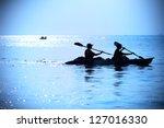 silhouette of woman kayaking   Shutterstock . vector #127016330