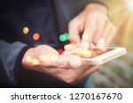 close up man hand hold using... | Shutterstock . vector #1270167670