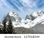 Nice scene with mountain rocks in winter time - stock photo