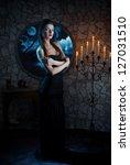 Fantasy style portrait of demonic woman in full moon night - stock photo